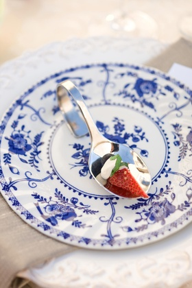 Strawberry on a spoon and china