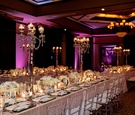 Long tables covered in sequin linens in dark lighting