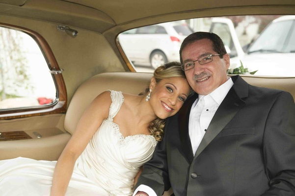 Father-of-the-bride inside champagne tan limo
