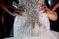 Bride in form fitting drop waist wedding dress jewel beads white manicure nails with rhinestones