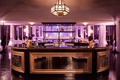 Gold and black wedding bar with purple lighting at Vibiana reception