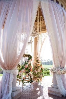 Billowing fabric from rotunda and gold birdcages