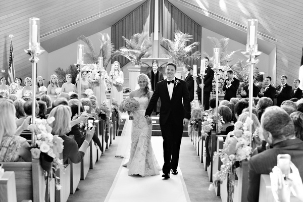 Black and white photo of bride in a strapless lace Anne Barge dress with groom in black tuxedo