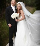 Wedding portrait full length with tuxedo groom and veil bride