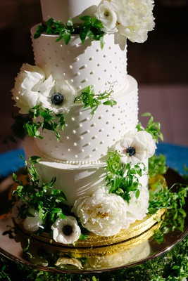 wedding cake white frosting pearl dots white peony anemone ranunculus flower green smilax