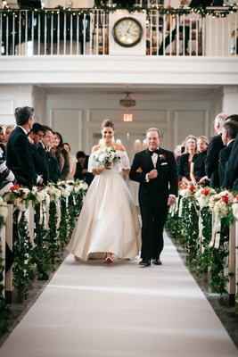 bride in off shoulder lace wedding dress with father of bride white original runner company aisle