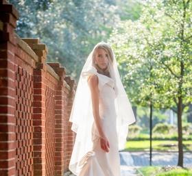 Bride in Oscar de la Renta bow bridal gown