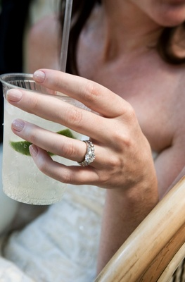 Margarita in cup and sparkling engagement ring
