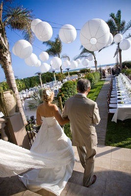 Oceanfront wedding reception with white paper lanterns