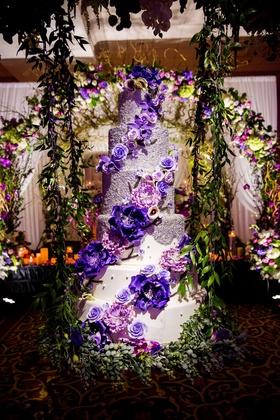 Wedding cake six layer purple flowers white fondant silver pearls greenery reception ideas swing