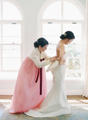 traditional korean wedding attire mother of bride in pink hanbok bride in bow dress strapless