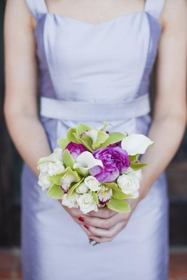 Bridesmaid holding nosegay of flowers