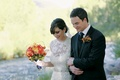Bride in a lace Monique Lhuillier gown and groom in a black tuxedo with vest