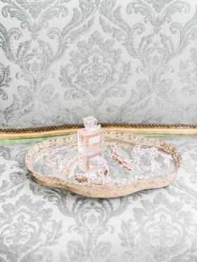 vintage bridal headpieces arranged on mirrored tray