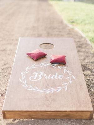 wooden cornhole board beanbags custom california boho chic wedding styled shoot entertainment rustic