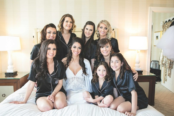 Short sleeve and short black silk pajamas for bridesmaids and flower girl with bride on bed in lace