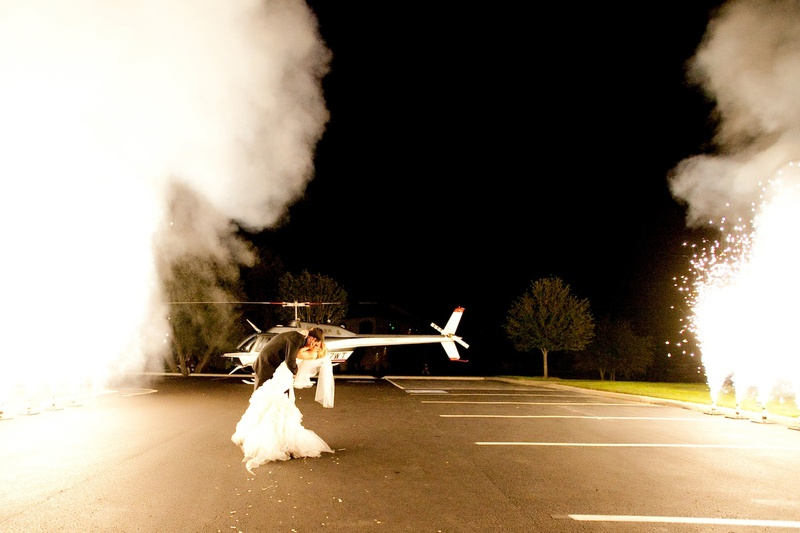 Couple kissing outside with helicopter and sparklers