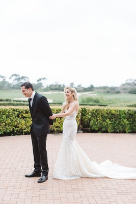couples shares first look california resort pelican hill newport beach wedding berta dress hotel