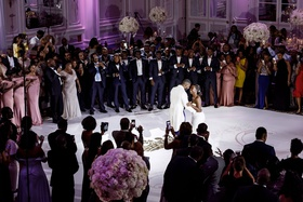 wedding reception first dance castle wedding snow falling during dance purple lighting
