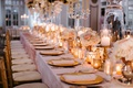 wedding reception pink linen long table gold chair charger plate candle votive vase candelabra