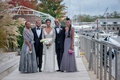 bride in berta wedding dress, bridesmaids in dusty purple, bride with family