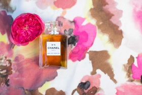 bottle of chanel no 5 five on top of pink floral table linen