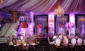 wedding reception designed by lily v events bright purple lighting drapery chandelier metallic gold