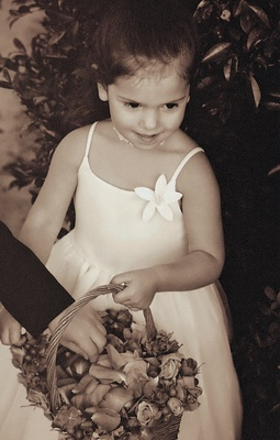 Black and white photo of a flower girl