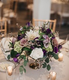 centerpiece with wildflowers, ivory dahlias, amnesia roses, succulents, eucalyptus, & purple blooms