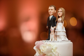 cake topper with bride and groom and their dog