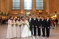 Couple with bridesmaids and groomsmen at Grand Central Station