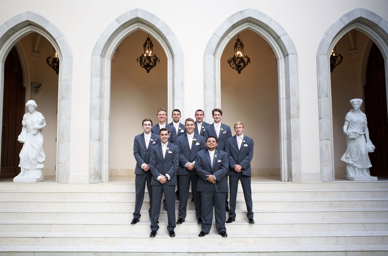 Wedding at chateau venue groomsmen in grey suits and pink ties