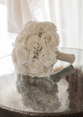 bridal bouquet with soft cream roses and pearl embellishments