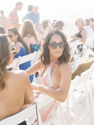 Wedding guest dress ideas pink halter sunglasses wedding outdoor Malibu CJ Perry Lana Brie Bella