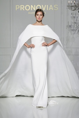 Column wedding dress with cape by Pronovias
