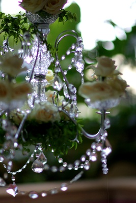 Sparkly crystal chandelier with white roses