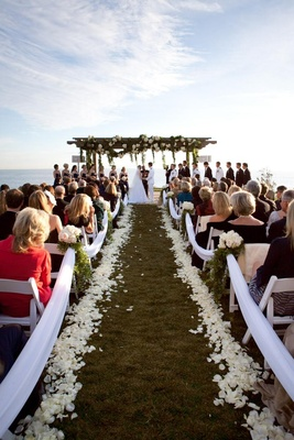 Ivory petal-lined aisle and wedding canopy