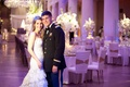 Bride and groom at reception with dress blues uniform