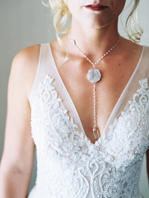 boho chic bride in lihi hod wedding dress wearing crystal drop necklace