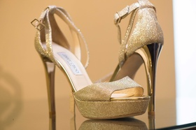 Peep toe gold metallic Jimmy Choo wedding day shoes with ankle strap and platform