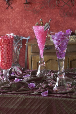 Crystal vessels filled with pink sweets