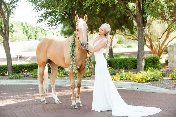 Wedding dress train v neck bride with horse portrait chestnut with greenery around neck white mane