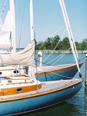 Wedding sail boat on river at venue wedding transportation idea for coastal nautical wedding