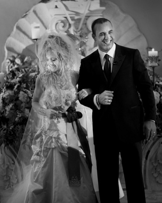 Black and white image of Madonna-inspired bride with groom