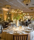 Ballroom wedding with white color palette and tulips