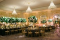 wedding reception ballroom venue gold chairs navy blue linens tablecloths high low