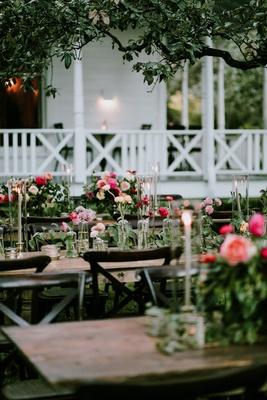 wedding reception long tables pink orange flowers taper candles farmhouse venue austin texas