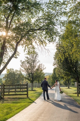 Bride in Alvina Valenta wedding dress with husband on farm