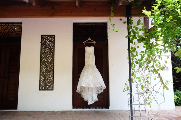lacy trumpet gown hanging door dominican republic wedding bride wedding train