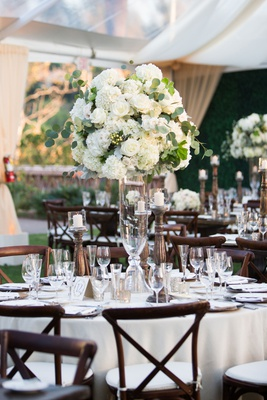 wedding reception tent white table wood vineyard chairs tall centerpiece spray rose hydrangea
